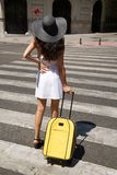 Stand on crosswalk with suitcase Stock Photo