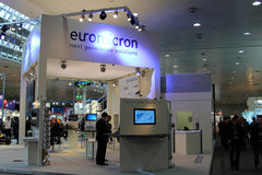 Stand of Euromicron in CEBIT computer expo. HANNOVER - MARCH 10: stand of Euromicron on March 10, 2012 at CEBIT computer expo, Hannover, Germany. CeBIT is the Stock Image