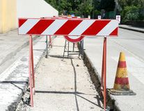 Stand excavation protection on the road Royalty Free Stock Photography