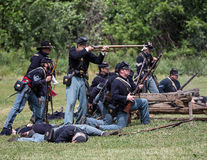 Stand and FIght. Civil War era soldiers in battle at the Dog Island reenactment in Red Bluff, California royalty free stock images