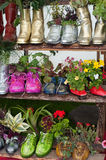 Stand with flowers planted in shoes Stock Image