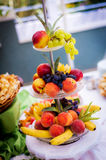Stand with fresh fruit Stock Images