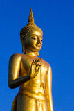 Stand Golden Buddha Statue in Thailand. Stand Golden Buddha Statue is on songkhla view point in Thailand Royalty Free Stock Images