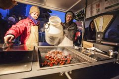 Stand with hot chestnut - winter specialty during christmas in Prague Stock Photos