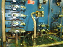 Stand of industrial hydraulic valves. Royalty Free Stock Image