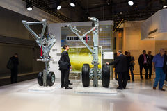 Stand by Liebherr and samples of aircraft landing gear. Stock Image