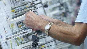 Stand for the manufacture of electrical automotive wiring.  stock video