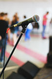 Stand with microphone on the stage prepared for the performance speaker Royalty Free Stock Images