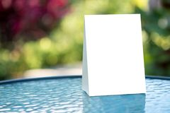 Free Stand  Mock Up Menu Frame  Tent Card  Blurred Background  Design Stock Photos - 109637493