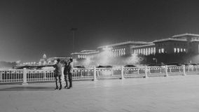 Stand in the Night of Tiananmen Square. Three men are looking at something,but also seemed to be thinking? This is a whole cold night in the midnight of Royalty Free Stock Photo