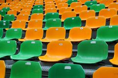 Grandstand at open air with colorful seats. Stand for an open air concert with plastic seats in green and orange Stock Photography