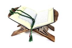 Stand with an opened Quran and rosary Stock Photos