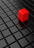 Stand out. A field of black tiles with one red block raised above the rest royalty free illustration