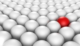 Stand Out. 3D rendered illustration of a red sphere stand - out surrounded by a crowd of white spheres Stock Image