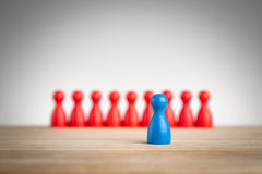 Stand out and be unique - leadership business concept with pawns Stock Images