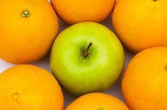 Stand out from crowd. With apple and oranges Stock Photos