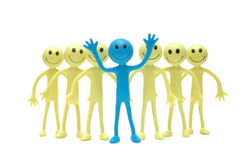 Stand out from the crowd. Figures of Smilies Royalty Free Stock Images