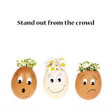 Stand out for the crowd. Stand out from the crowd concept. Three eggheads with cartoon faces, two with the usual cress hair and one with hair of daisies Stock Photo