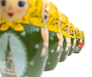 Stand out from the crowd. Russian dolls with one standing out from the crowd stock images