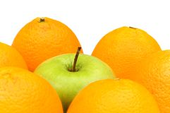 Stand out from crowd with apple and oranges. Stand out from crowd  with apple and oranges Royalty Free Stock Photography