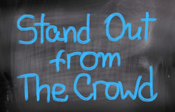 Stand Out From The Crowd Concept. Concept Handwritten With Chalk On A Blackboard royalty free stock photos