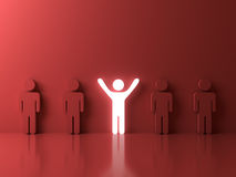 Stand out from the crowd and different creative idea concepts , One glowing light man standing with arms wide open. Among other people on red background with Stock Image
