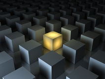 Stand out from the crowd and different creative idea concepts , One glowing yellow light cube. Among other dim cubes on dark gray background with reflections Stock Photos
