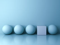Stand out from the crowd and different creative idea concepts , One white square box standing among blue spheres on blue. Background in the row with reflections Stock Photo