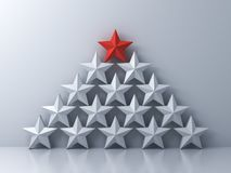 Stand out from the crowd and Leadership creative idea concepts One red star standing on top of other white stars on white royalty free stock images