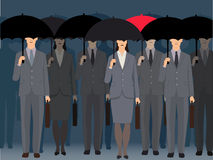 Stand out from the crowd. A man with a red umbrella standing an a crowd of faceless business people under black umbrellas, vector illustration Stock Photography
