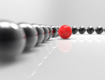 Stand out from the crowd. Red leader,spheres Royalty Free Stock Image