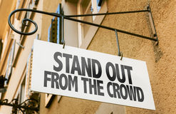Stand Out From the Crowd sign in a conceptual image Royalty Free Stock Photos