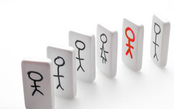 Stand out from the crowd. Stick figure dominoes stick out from the crowd stock image