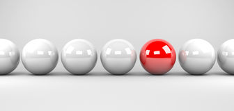 Stand out from the masses. 3d render illustration - red sphere stands out Royalty Free Stock Image