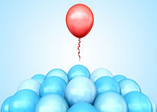 Stand out. Red balloon flying away from  crowd Royalty Free Stock Photography
