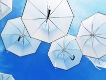 Stand out umbrellas. And blue sky at Stock Images