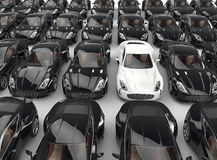 Stand out white car among many black cars Royalty Free Stock Photos
