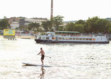 Stand Paddle Boarding. Man paddling on the surfboard at Vltava River, Prague Stock Images