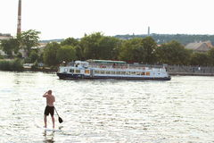 Stand Paddle Boarding. Man paddling on the surfboard at Vltava River, Prague Stock Photo