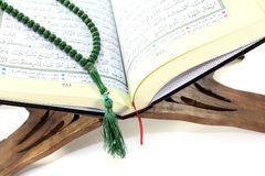 Stand with Quran and rosary Stock Images
