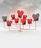 Stand with red hearts on cloudy black and white sky Royalty Free Stock Images