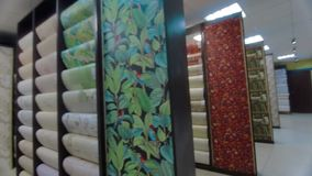 Stands with rolls of wallpaper Samples in store. Stand with rolls of wallpaper. Samples in the store stock video footage