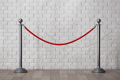 Stand Rope Barriers in front of Brick Wall Royalty Free Stock Images
