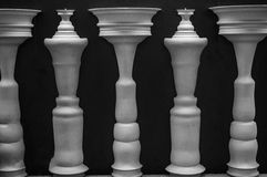 Stand in Shadows. Figures and figures make an optical illusion in black and white Stock Image