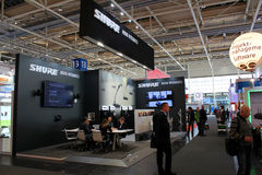 The stand of Shure on March 20, 2015. HANNOVER, GERMANY - MARCH 20: The stand of Shure on March 20, 2015 at CEBIT computer expo, Hannover, Germany. CeBIT is the Stock Image