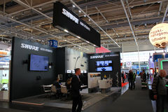 The stand of Shure on March 20, 2015. HANNOVER, GERMANY - MARCH 20: The stand of Shure on March 20, 2015 at CEBIT computer expo, Hannover, Germany. CeBIT is the Stock Photography