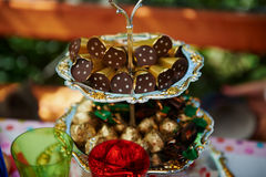 Stand for sweet table with chocolate and sweets. Royalty Free Stock Photo