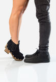 Stand on toes to kiss Stock Images