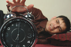 Stand up. Angry man with clock Stock Photos