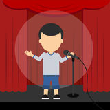Stand up comedy. Male presenter and comedian standing at the scene with red curtains and spotlight Royalty Free Stock Photography